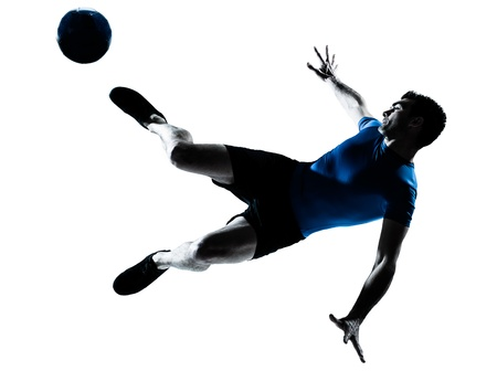 indoor soccer: one caucasian man flying kicking playing soccer football player silhouette  in studio isolated on white background Stock Photo