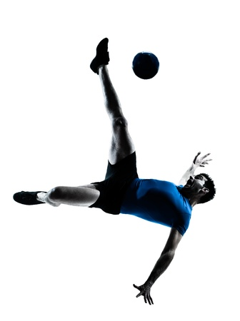 one caucasian man flying kicking playing soccer football player silhouette  in studio isolated on white background photo
