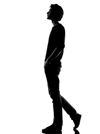 shadow people: young man  walking happy smiling silhouette in studio isolated on white background