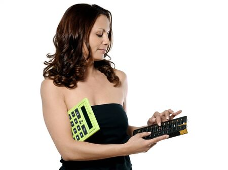 Portrait of beautiful woman using abacus and holding calculator in studio isolated on white background photo