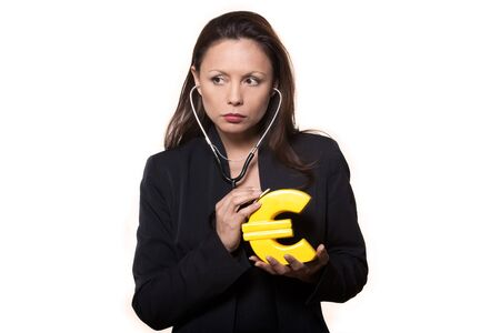 Portrait of expressive woman examining euro and looking away in studio isolated on white background Stock Photo