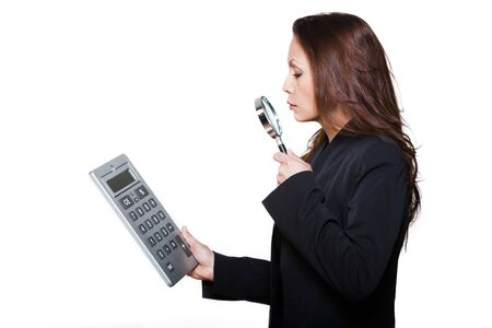 Portrait of woman with large calculator and magnifying glass in studio isolated on white background photo