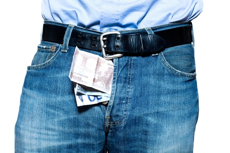 prostitution: Detail shot of Euro currency in blue denim jeans in studio isolated on white background