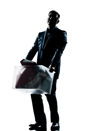 man carrying box: one caucasian man full length silhouette in studio isolated white background