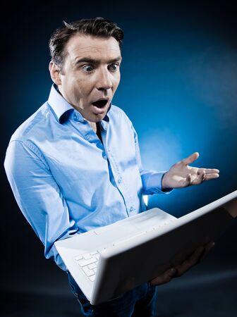 caucasian man stun computer breakdown portrait isolated studio on black background