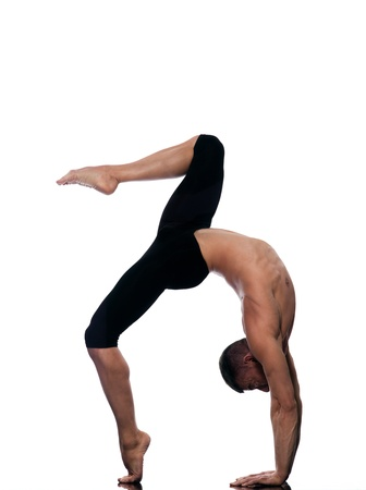 male ballet dancer: caucasian man stretching gymnastic acrobatics isolated studio on white background