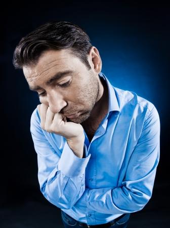 to sulk: caucasian man unshaven portrait sulk tired isolated studio on black background