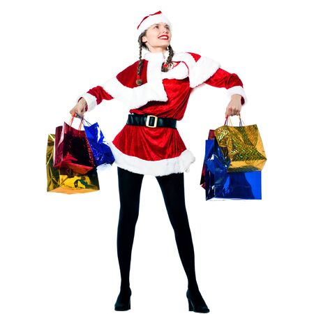 one woman dressed as santa claus carrying christmas bags  on studio isolated white background photo