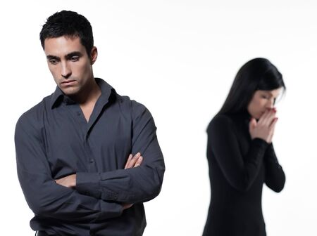 moody: one young couple relationship difficulties dispute with woman crying on studio isolated white background Stock Photo