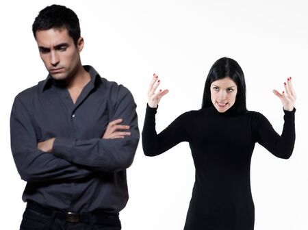 young couple on white background having a dispute photo