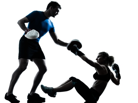 one caucasian couple man woman personal trainer coach man woman boxing training silhouette studio isolated on white background Stock Photo - 13888539