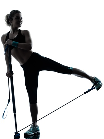 one caucasian woman exercising gymstick  fitness workout posture in silhouette studio isolated on white background photo