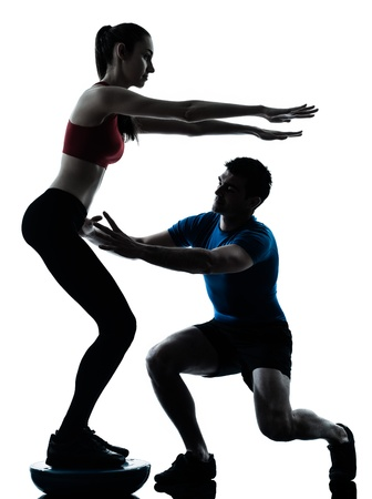 personal trainer man coach and woman exercising squats on bosu silhouette  studio isolated on white background Stock Photo - 13888536