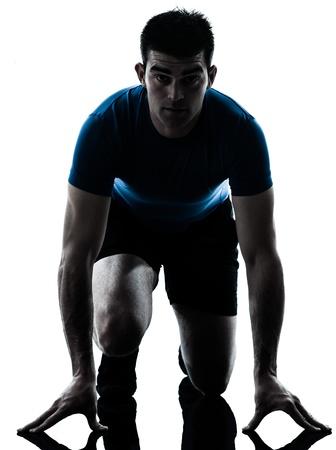 aerobic exercise: one caucasian man runner running sprinter sprinting  in silhouette studio  isolated on white background