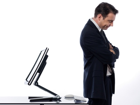 to sulk: caucasian man and a computer display monitor on isolated white background expressing  bug  conflict rejection concept