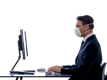 anti virus: caucasian man cumputing computer wearing protection mask concept isolated studio on white background