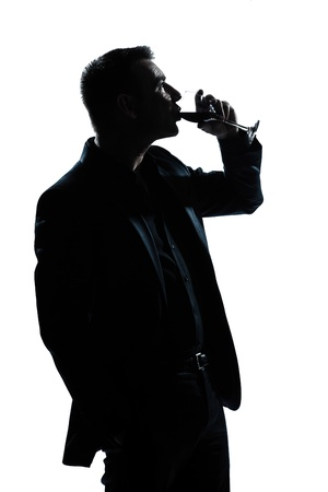 one caucasian man portrait silhouette drinking red wine in studio isolated white background photo