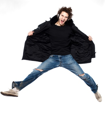 studio portrait of one  caucasian young man listening to music music jumping screaming isolated on white background photo