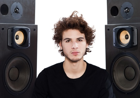 studio portrait of a one caucasian young man listening to music lover with speakerphones isolated on white background Stock Photo - 13888677
