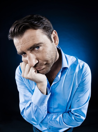 caucasian man unshaven portrait sulk bored isolated studio on black background Stock Photo - 13888675