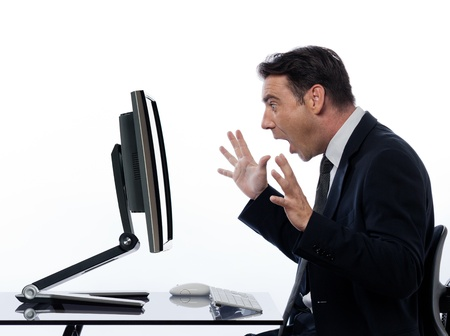is astonished: one caucasian business man  computing and a computer display monitor on isolated white background