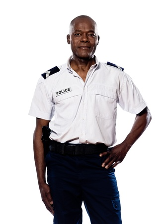 security laws: Portrait of a smart afro American policeman smiling with hand on waist in studio on white isolated background
