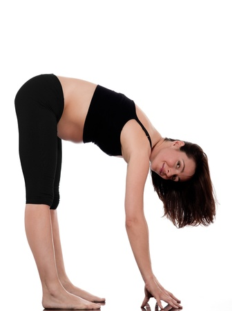 girl belly: pregnant caucasian woman stretch workout isolated studio on white background