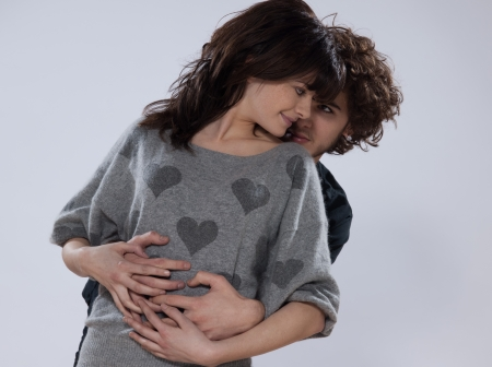 beuatiful caucasian young couple wearing a sweater with hearts on it photo
