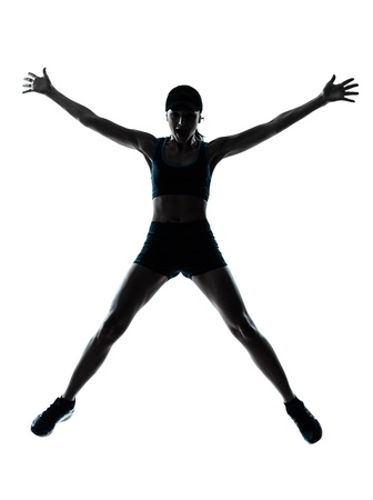 female athlete: one caucasian woman runner jogger jumping happy jumping in silhouette studio isolated on white background