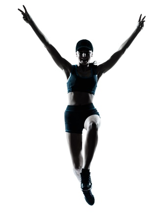 victorious: one caucasian woman runner jogger victorious jumping in silhouette studio isolated on white background Stock Photo