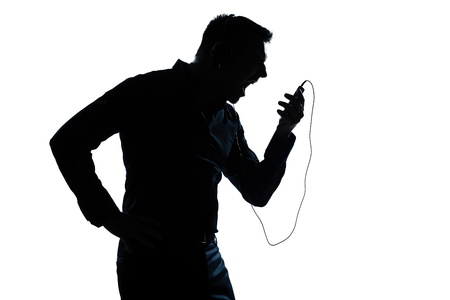 portable mp3 player: one caucasian man  telephone videophone  portrait silhouette in studio isolated white background