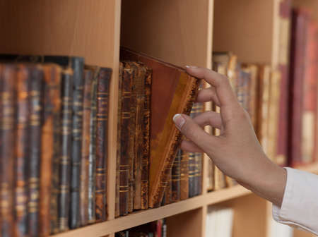woman hand holding ancient book Stock Photo - 13861905