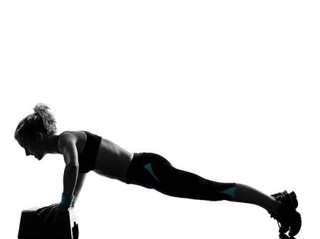 pushups: one woman exercising workout fitness aerobic exercise abdominals push ups posture on studio isolated white background Stock Photo