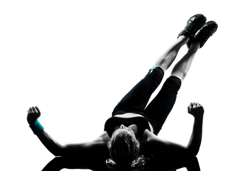 back exercise: one woman exercising workout fitness aerobic exercise abdominals push ups posture on studio isolated white background Stock Photo