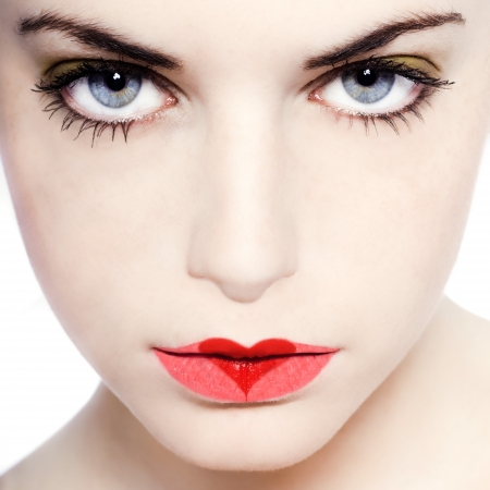 young beautiful caucasian woman playing with heart drawing on lips photo