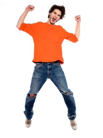 one expressive caucasian young man screaming happy joy full length in studio on white background photo