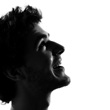 man face profile: young man looking up smiling happy portrait silhouette in studio isolated on white background