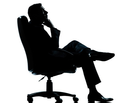 sit up: one caucasian business man relaxing thinking sitting in armchair silhouette Full length in studio isolated on white background