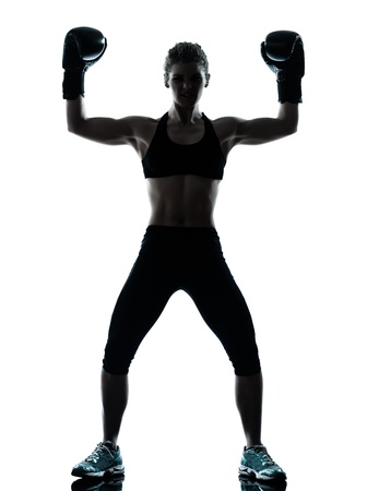 gymnastics silhouette: one caucasian woman exercising boxe fitness workout posture in silhouette studio isolated on white background Stock Photo