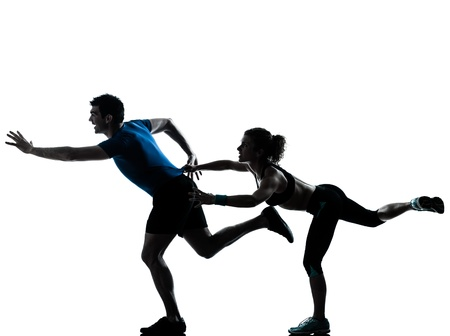 one caucasian couple man woman personal trainer coach runner running jogging sprinting silhouette studio isolated on white background photo
