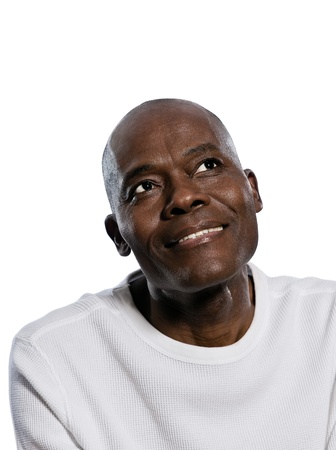 1 mature man: Close-up of a thoughtful afro American handsome man looking up in studio on white isolated background