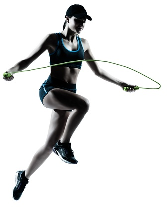 one caucasian woman runner jogger jumping rope in silhouette studio isolated on white background Stock Photo - 14388240