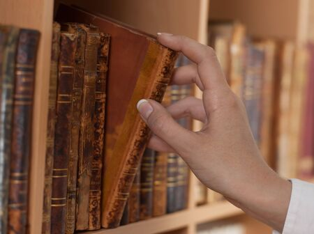 woman hand holding old book library close up Stock Photo - 14070814