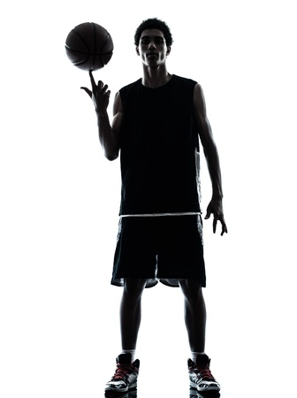 ombres: one young man basketball player silhouette in studio isolated on white background Stock Photo