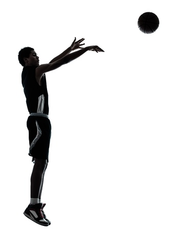 a l ecart: one young man basketball player silhouette in studio isolated on white background Stock Photo