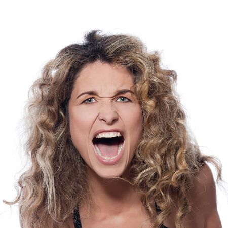 shout: beautiful caucasian woman angry portrait isolated studio on white background