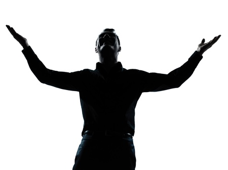 man looking out: one caucasian business man happy arms outstretched portrait silhouette in studio isolated on white background