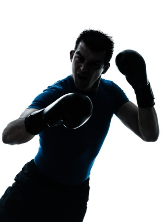 regards objectifs: one caucasian man exercising boxing boxer  workout fitness in silhouette studio  isolated on white background