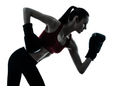 a l ecart: one caucasian woman boxing exercising in silhouette studio  isolated on white background