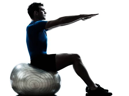 ombres: one caucasian man exercising workout fitness ball in silhouette studio  isolated on white background